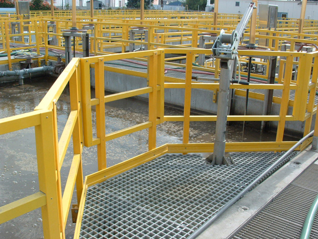 Fiber Glass Reinforced Plastic Corrosion Resistant Molded Grating and Yellow Railing in Wastewater Treatment Facility